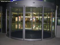 Automatic curved glass door for event center